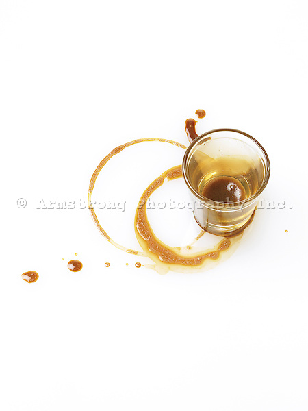 empty espresso shot glass, coffee spill