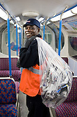 A cleaner collects discarded newspapers from carriages at London Underground's Northumberland Park Depot, which services the 42 tube trains on the Victoria line.