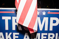 An American flag hangs near a Trump campaign sign outside the Sheraton Portsmouth Harborside Hotel in Portsmouth, New Hampshire, USA. At the hotel later that evening, Republican presidential candidate and real estate mogul Donald Trump received an endorsement from the New England Police Benevolent Association executive council. A small group of perhaps 20 Trump supporters stood outside the hotel and there was a larger group of anti-Trump protesters, mostly across the street. One of the protest organizers estimated that there were around 230 protesters gathered.Many protesters expressed disagreement with Trump's recent statements that he would ban all Muslims from entering the country. Trump brought up the recent shooting in San Berdardino, Calif., at the meeting.