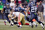 San Francisco 49ers quarterback Alex Smith is sacked by from Seattle Seahawks Alan Branch at  CenturyLink Field in Seattle, Washington on December 24, 2011.  The 49ers came from behind to beat the Seahawks 19-17. ©2011 Jim Bryant Photo. All Rights Reserved.