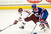 Chris Kreider (BC - 19), Riley Wetmore (Lowell - 16) - The Boston College Eagles defeated the visiting University of Massachusetts-Lowell River Hawks 5-3 (EN) on Saturday, January 22, 2011, at Conte Forum in Chestnut Hill, Massachusetts.