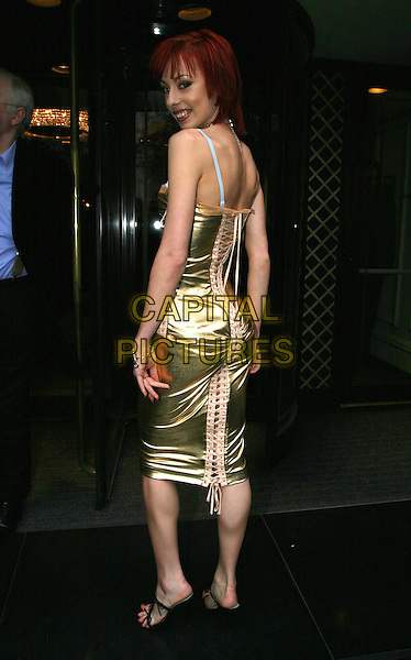 CHEEKY GIRLS.leaving the TRIC awards at the Grosvenor House hotel.09 March 2004.full length, full-length, gold metallic dress, lace-up, tie-up, black strappy sandals, heels.www.capitalpictures.com.sales@capitalpictures.com.© Capital Pictures.