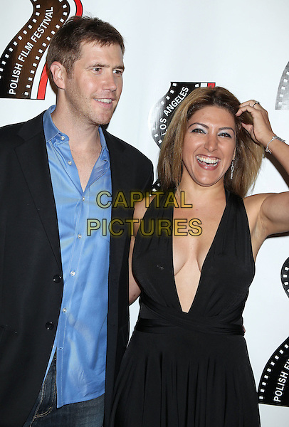 Jake Head, Michelle Alexandria<br /> 13th annual Polish film festival at American Cinematheque's Egyptian Theatre, Hollywood, California, USA.<br /> 9th October 2012<br /> half length dress plunging neckline cleavage hand arm smiling blue shirt black suit jacket  <br /> CAP/ADM/RE<br /> &copy;Russ Elliot/AdMedia/Capital Pictures