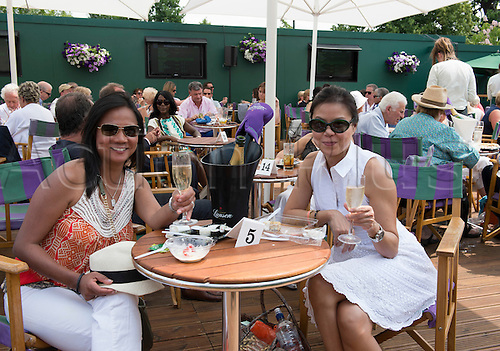 05.07.2013. Wimbledon, London England.  The Wimbledon Tennis Championships 2013 held at The All England Lawn Tennis and Croquet Club, London, England, UK.  Fans enjoying champagne prior to the start of the tennis.