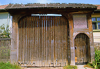 Ornamental painted carved wood Szekely village farm gate. Transylvania, Romania.