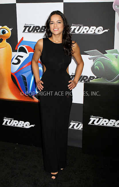 WWW.ACEPIXS.COM<br /> <br /> July 9 2013, New York City<br /> <br /> Michelle Rodriguez arriving at the 'Turbo' Premiere at AMC Loews Lincoln Square on July 9, 2013 in New York City. <br /> <br /> <br /> By Line: Nancy Rivera/ACE Pictures<br /> <br /> <br /> ACE Pictures, Inc.<br /> tel: 646 769 0430<br /> Email: info@acepixs.com<br /> www.acepixs.com