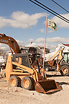 "February 27, 2013. Holgate, New Jersey. A front loader used to dismantle destroyed homes flies the ""Restore the Shore"" flag in a trailer park that has no livable residences after Hurricane Sandy hit the area.. Tracing the path of Hurricane Sandy, which wrecked havoc on the northeastern seaboard from October 25-31, 2012. The storm caused flooding and caused an estimated 60 billion dollars worth of damage to affected areas."