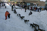 Jeff King leaves the Anchorage start line on 4th avenue during the start of the Iditarod.