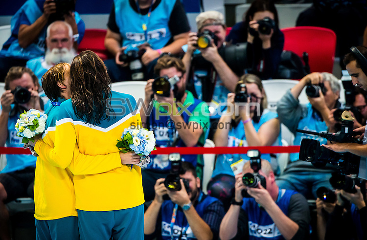 Picture by Alex Whitehead/SWpix.com - 07/08/2015 - Swimming - 16th FINA World Swimming Championships 2015 - Kazan Arena Stadium, Kazan, Russia - Australia's Bronte (L) and Cate Campbell (R) celebrate winning Gold and Bronze respectively in the Women's 100m Freestyle final.