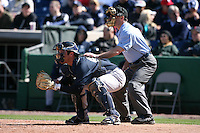 March 4, 2010:  Catcher Austin Romine of the New York Yankees and home plate umpire Dan Iassogna during a Spring Training game at Bright House Field in Clearwater, FL.  Photo By Mike Janes/Four Seam Images