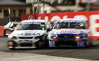 James Courtney (left) squeezes past Steven Richards at Holden Hairpin in Race Two during Day Three of the Hamilton 400 Aussie V8 Supercars Round Two at Frankton, Hamilton, New Zealand on Sunday, 19 April 2009. Photo: Dave Lintott / lintottphoto.co.nz