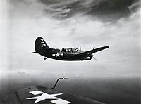 SB2C #74 of Shangri-La's VB-85 in air  - Aug. 22, 1945<br /> <br /> Photo by R.J. Guttosh