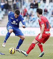 Getafe's Xavi Torres (l) and Osasuna's Alvaro Cejudo during La Liga match.December 15,2012. (ALTERPHOTOS/Acero) /NortePhoto