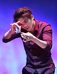 """Shin Lim, """"The Manipulator"""" from the cast of Broadway's """"The Illusionists—Magic of the Holidays"""" on stage for a press preview at the Marquis Theatre  on November 27, 2018 in New York City."""