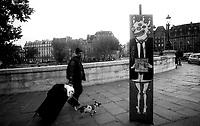 10.2009 <br /> <br /> Homeless walking with his dog behind a poster where it is written &quot;support rich people&quot;.<br /> <br /> Sans abris marchant avec son chien derri&egrave;re une affiche ou il est ecrit &quot;soutenez les riches&quot;.