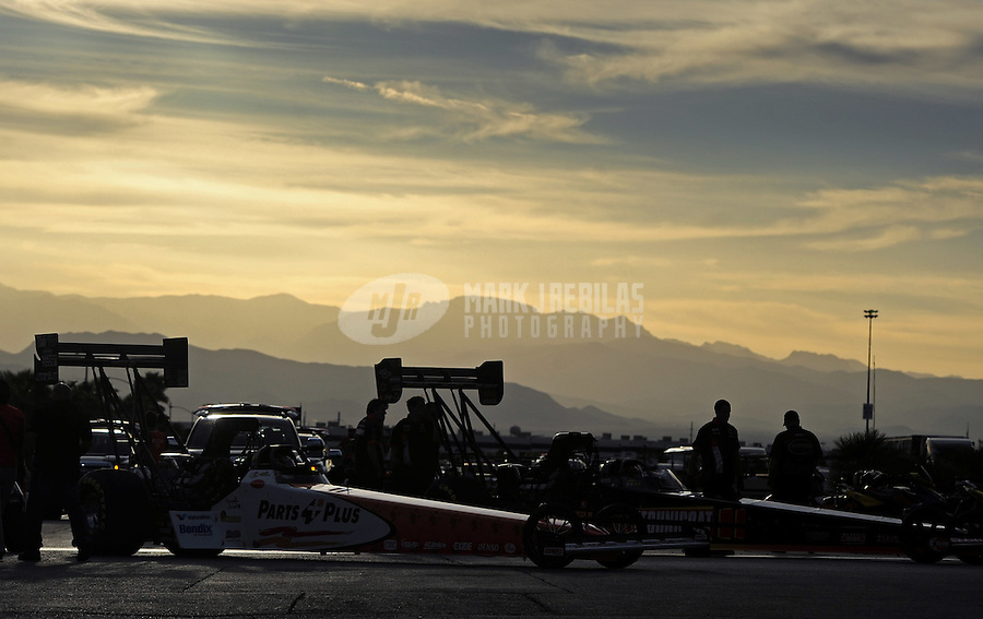 Mar. 30, 2012; Las Vegas, NV, USA: The cars of NHRA top fuel dragster drivers Clay Millican (near) and David Grubnic in the staging lanes prior to racing during qualifying for the Summitracing.com Nationals at The Strip in Las Vegas. Mandatory Credit: Mark J. Rebilas-US PRESSWIRE