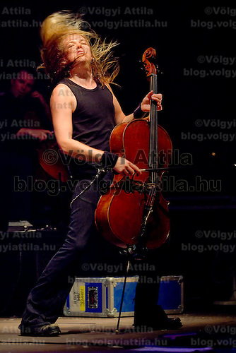 Eicca Toppinen, member of finnish cello metal band Apocalyptica performing on Sziget festival attracting more than 75 thousand participants.