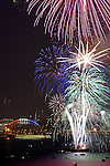 Seattle, Fourth of July fireworks; Qwest Field, Seahawks Stadium, Port of Seattle, Elliott Bay, Puget Sound, Washington State, Pacific Northwest.