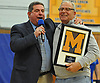 Massapequa varsity gymnastics coach Mike Capone, right, gets congratulated by Nassau County Section VIII Sports Executive Director Pat Pizzarelli for 42 years of coaching before the county's team championship meet at Berner Middle School in Massapequa on Thursday, Feb. 15, 2018.