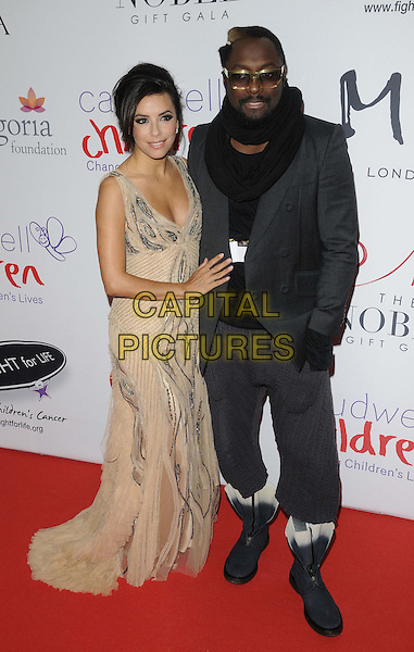 Eva Longoria & Will.i.am.attended the Noble Gift Gala, ME London, The Strand, London, England, UK, 8th December 2012..full length beige nude dress silver long maxi sleeveless glasses grey gray suit  boots black scarf jacket trousers .CAP/CAN.©Can Nguyen/Capital Pictures.