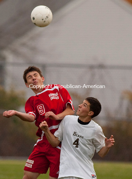 THOMASTON, CT, 20 OCTOBER 2010-102010JS09-Wamogo's Labinot Mersini (9) heads the ball  in front of Thomaston's Kenny Beniot (4) during their game Wednesday at Highland Farms Field in Thomaston, <br />  Jim Shannon Republican-American