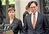 Jo Bennet Marsh, left, attorney for Sidney Blumenthal, right, reads a statement for her client following their day at United States District Court in Washington, DC in response to a Ken Starr subpoena in the Monica Lewinsky case on February 24, 1998. <br /> Credit: Ron Sachs / CNP