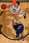SIOUX FALLS, SD - MARCH 10:  Marshall Bjorklund #42 from North Dakota State University tries a reverse lay-up past  Brad Reid #33 from UMKC in the second half of their semifinal game Sunday evening at the 2013 Summit League Basketball Tournament in Sioux Falls. SD. (Photo by Dave Eggen/Inertia)