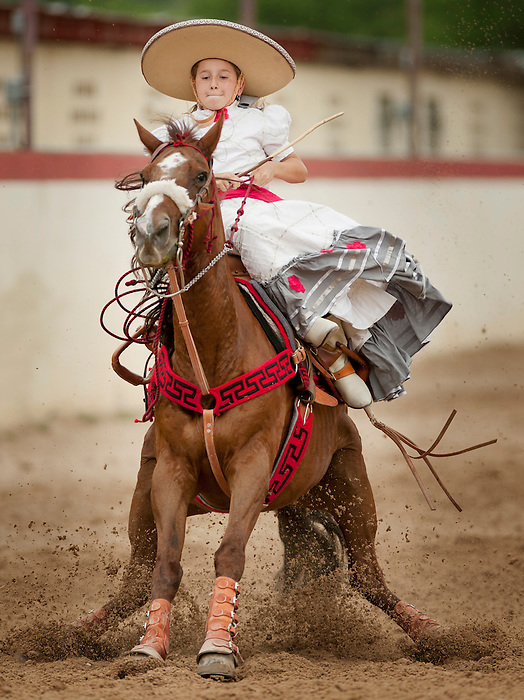 An escaramuza rider performs during Fiesta Charreada, Sunday, April 29, 2012, at San Antonio Charro Ranch in San Antonio, TX, USA. (Darren Abate/pressphotointl.com)