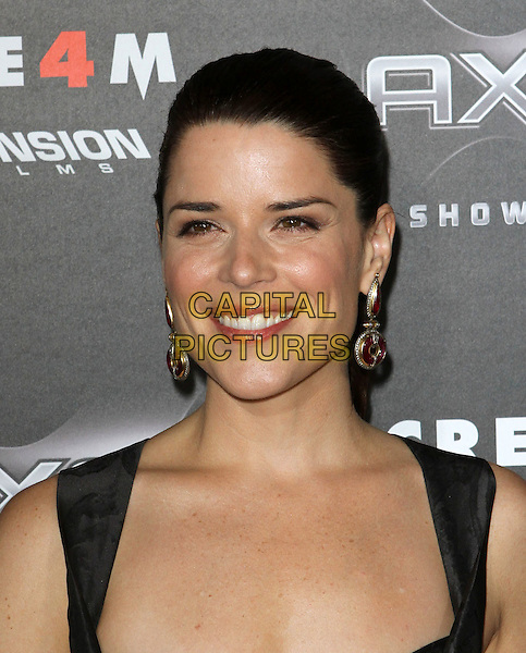 "NEVE CAMPBELL.""Scream 4"" Los Angeles Premiere Held At The Grauman Chinese Theatre, Hollywood, California, USA..April 11th, 2011.scre4m headshot portrait black red gold earrings dangly hair up red smiling .CAP/ADM/KB.©Kevan Brooks/AdMedia/Capital Pictures."