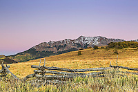Dallas Peak at sunset. Dallas Peak is on the San Juan Mountains south of Ridgeway Colorado.  Snake rail fenses are a local favorite and many can be found along Last Dollar Road.