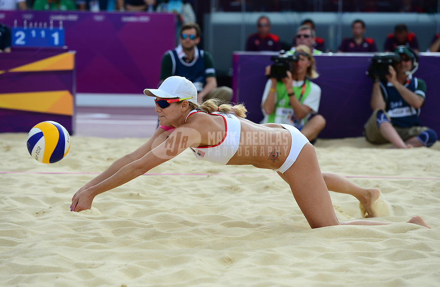 Aug. 2, 2012; London, United Kingdom; USA player Jennifer Kessy dives for a ball against Spain during the women's beach volleyball  preliminary at the London 2012 Olympic Games at Horse Guards Parade. USA defeated Spain 2 sets to 1. Mandatory Credit: Mark J. Rebilas-USA TODAY Sports