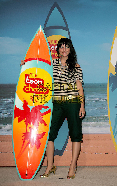 ASHLEE SIMPSON.The 2004 Teen Choice Awards held at The Universal Ampitheatre in Universal City, California.August 8, 2004.full length, surf board, gold belt, shoes, striped shirt, black three quarter length trousers.www@capitalpictures.com.sales @capitalpictures.com.©Capital PIctures