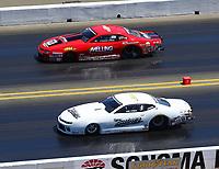 Jul 30, 2017; Sonoma, CA, USA; NHRA pro stock driver Bo Butner (near) races alongside Erica Enders-Stevens during the Sonoma Nationals at Sonoma Raceway. Mandatory Credit: Mark J. Rebilas-USA TODAY Sports