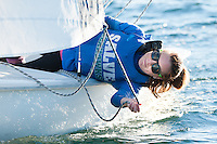 Salve's Crete Clifford, crew, works the sail during practice in the Newport Harbor.