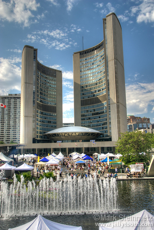 Toronto Outdoor Art Exhibition in Nathans Philllips Square in front of Toronto City Hall in July.