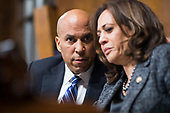 UNITED STATES - SEPTEMBER 27: Sens. Cory Booker, D-N.J., and Kamala Harris, D-Calif., are seen during testimony by Judge Brett Kavanaugh during the Senate Judiciary Committee hearing on his nomination be an associate justice of the Supreme Court of the United States, focusing on allegations of sexual assault by Kavanaugh against Christine Blasey Ford in the early 1980s. (Photo By Tom Williams/CQ Roll Call)