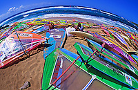 Windsurfing boards scattered at famous windsurfing beach Hookipa, Maui
