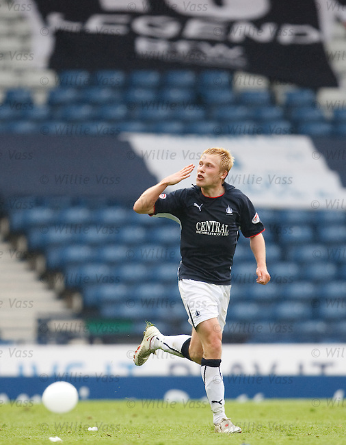 Scott Arfield scelebrates scoring Falkirk's penalty to seal the tie