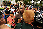 Shawn Caldwell (C) is asked to step back by police as he argues with a supporter of George Zimmerman as demonstrators gather and wait for a verdict in the trial of George Zimmerman at the Seminole County Criminal Justice Center in Sanford, Florida, USA, 13 July 2013. Zimmerman, a former volunteer neighborhood watch captain, had been charged with second-degree murder in the 26 February 2012 shooting death of 17 year-old Trayvon Martin in Sanford, Florida.