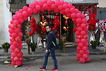 A Palestinian youth walks past a shop selling red teddy bears, red ballons and pillows on Valentine's day in Gaza city on February 14, 2018. Valentine's Day is increasingly popular in the region as people have taken up the custom of giving flowers, cards, chocolates and gifts to sweethearts to celebrate the occasion. Photo by Ashraf Amra