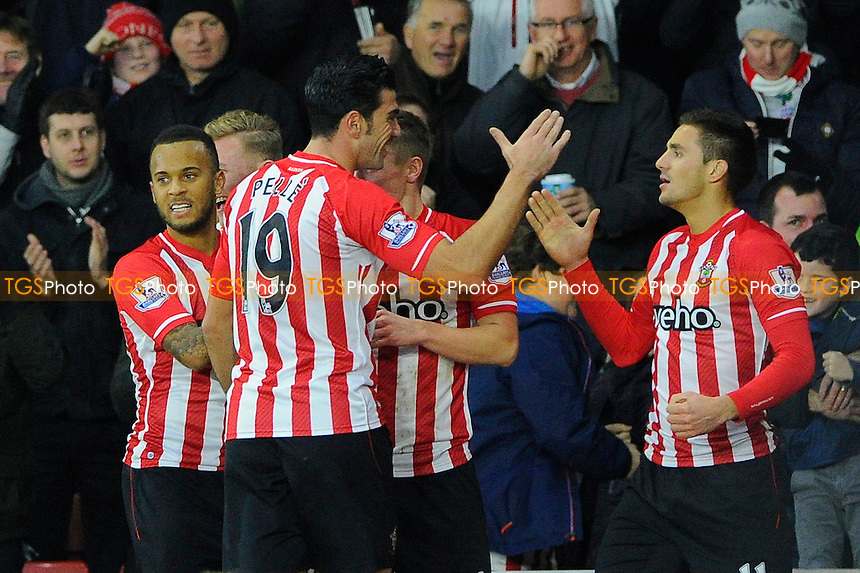 as11` right is congratulated by Graziano Pelle of Southampton after scoring the scone goal - Southampton vs Arsenal - Barclays Premier League Football at St Mary's Stadium, Southampton, Hampshire - 01/01/15 - MANDATORY CREDIT: Denis Murphy/TGSPHOTO - Self billing applies where appropriate - contact@tgsphoto.co.uk - NO UNPAID USE