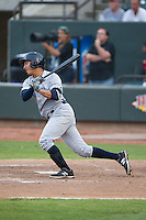 Mauricio Ramos (29) of the Wilmington Blue Rocks follows through on his swing against the Winston-Salem Dash at BB&T Ballpark on June 10, 2015 in Winston-Salem, North Carolina.  The Blue Rocks defeated the Dash 11-5.  (Brian Westerholt/Four Seam Images)