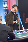 "Kido Pham stares and talks to Gary Kainer.  Pham made a mistake and did not mean to make the call.  He said ""I will call it"" meaning to make the decision about calling or folding.  Tournament Director ruled that his verbal action stands.  Pham then winces when he has to turn over his hand."