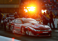 Jul 8, 2016; Joliet, IL, USA; Crew member guides NHRA pro stock driver Greg Anderson to the starting line as the sun sets during qualifying for the Route 66 Nationals at Route 66 Raceway. Mandatory Credit: Mark J. Rebilas-USA TODAY Sports