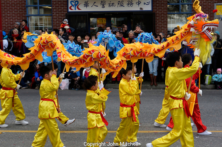 Young dragon dancers perform for crowds at the 41st annual Chinese New Year Parade in Chinatown, Vancouver, BC, Canada. The 2014 celebrations mark the beginning of the Year of the Horse in the traditional Chinese lunar calendar.