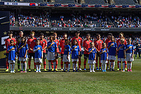 CHICAGO, IL - OCTOBER 06: Korea Republic and player escorts during a game between the USA and Korea Republic at Soldier Field, on October 06, 2019 in Chicago, IL.