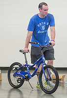 NWA Democrat-Gazette/ANTHONY REYES &bull; @NWATONYR<br /> Kyle McGenley, with Sonora Elementary School, wheels a completed 20-inch bike to a mechanic for final inspection Wednesday, Aug. 12, 2015 at Sonora Elementary School in Springdale. The school purchased 32 bikes through a grant from the Walton Family Foundation for use in the school physical education department.