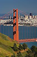 Golden Gate Bridge details with San Francisco skyline in background, San Francisco, California.