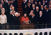 Nixon is sworn in as the 37th President by Chief Justice Earl Warren on January 20, 1969, with the new First Lady, Pat, holding the family Bibles.<br /> <br /> PHOTO : Oliver F. Atkins