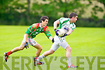 St Brendan's David Culloty gets away from St Micheal's/Foilmore Eanna O'Connor in the Kerry senior football championship at Blennerville on Saturday.